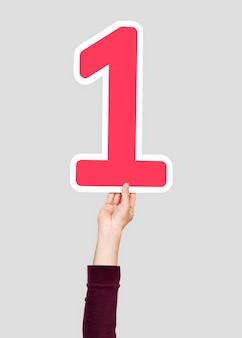 Hand hält die nummer 1