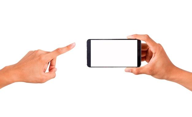 Hand hält die smartphone- und notenhand