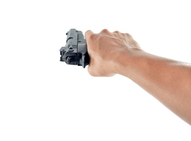 Hand hält eine pistole