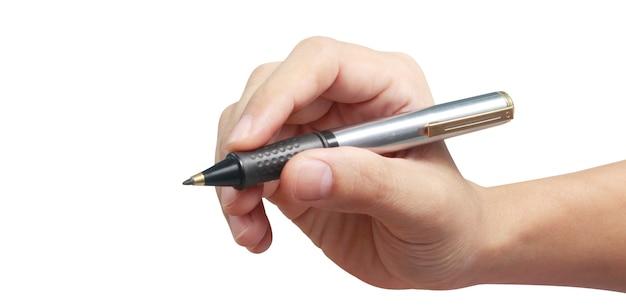Hand hält einen stift, der etwas text schreibt
