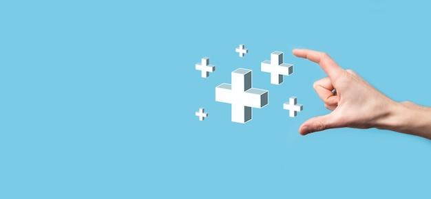 Hand halten 3d-plus-symbol, mann in der hand halten bietet positive dinge wie gewinn, vorteile, entwicklung, csr, dargestellt durch pluszeichen. die hand zeigt das pluszeichen