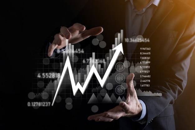 Hand halten verkaufsdaten und wirtschaftswachstumsdiagramm. unternehmensplanung und strategie. analyse des börsenhandels. finanz- und bankwesen. digitales marketing der technologie. profit und wachstumsplan.