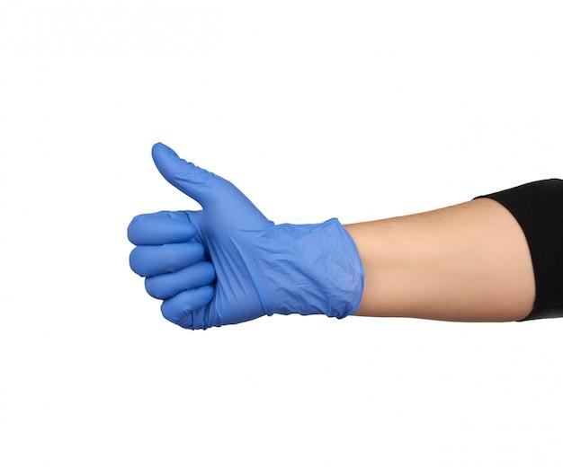 Hand in blauem medizinischen handschuh zeigt rechtshändige geste wie