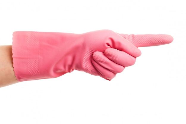 Hand in einem rosa haushandschuh zeigt