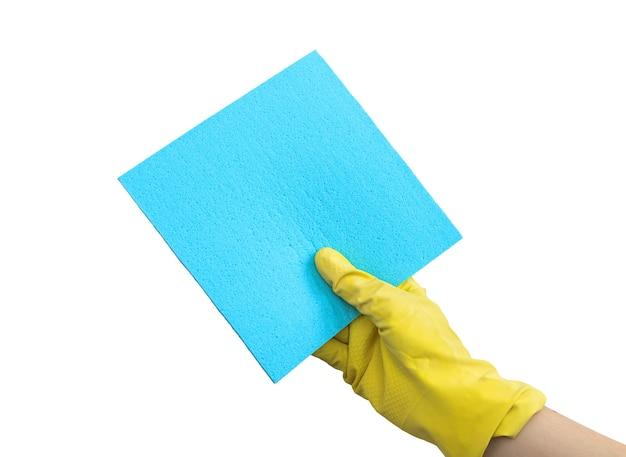 Hand in gelben handschuh mit lappen isoliert auf einem weißen hintergrundfoto