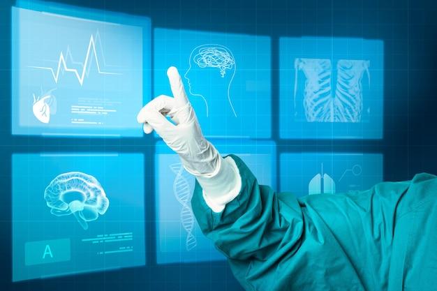 Hand in medizinischem handschuh, der auf medizintechnik mit virtuellem bildschirm zeigt
