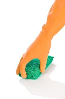 Hand in orangefarbenen handschuh