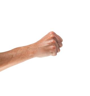 Hand mit ballte eine faust, die auf weiß lokalisiert wurde