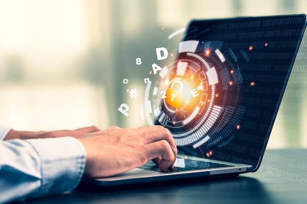 Hand mit computer-laptop durch eingabe des passworts, um sich anzumelden und auf das computersystem zuzugreifen. sicherheit im technologiekonzept.