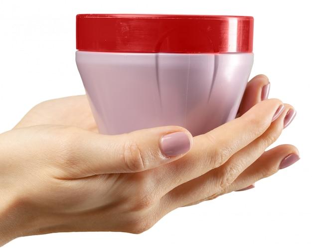 Hand mit einer kosmetischen flasche