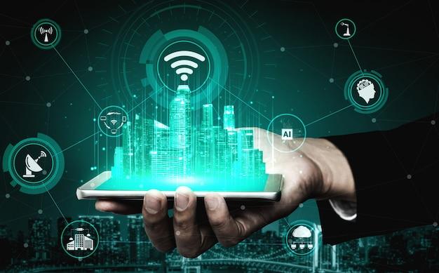 Hand mit gerät, das hologramme mit technologie des internet-netzwerks hält