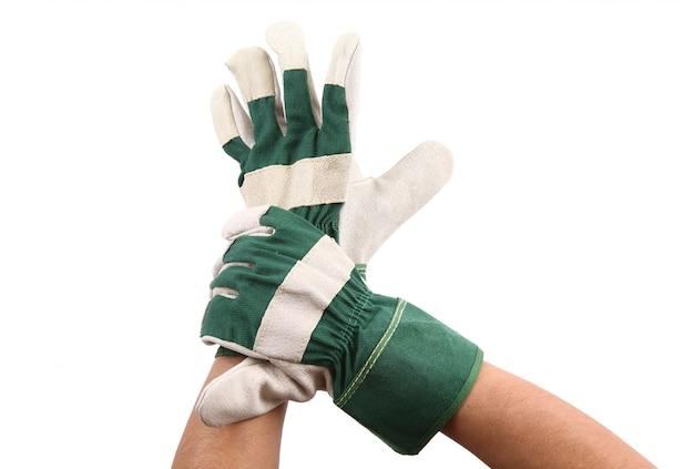 Hand mit handschuh auf weiß