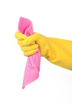 Hand mit handschuh und schwamm auf weiß