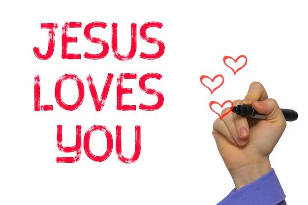 Hand mit marker schreiben das wort jesus liebt dich