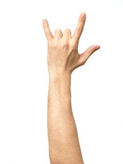 Hand, welche die teufelhörner geste gibt