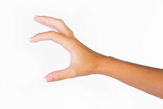 Hand zeigt mittlere menge mit den fingern