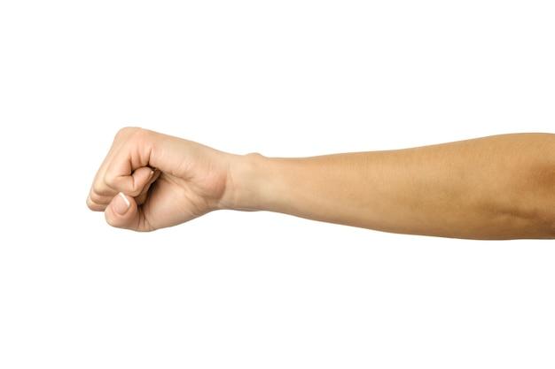 Hand zu einer faust geballt. horizontales bild. frauenhand mit französischer maniküre gestikuliert lokalisiert auf weißer wand. teil der serie