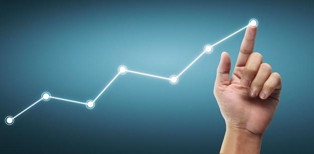 Handberührende diagramme des finanzindikators und des diagramms der marktwirtschaftsanalyse des rechnungswesens