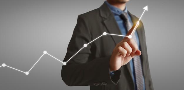 Handberührende diagramme des finanzindikators und des marktwirtschaftsanalysediagramms des rechnungswesens