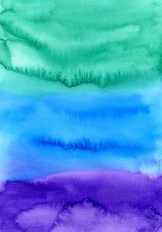 Handgemalter hintergrund des abstrakten aquarells. bunte beschaffenheit in den grünen, blauen und purpurroten farben.