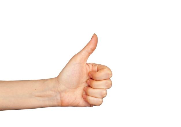Handgeste - daumen hoch, lokalisiert auf weißem hintergrund. die weibliche handfläche zeigt auf etwas, das für ihr design leer ist.