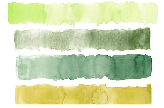 Handgezeichneter aquarellpinselstrich in grüner erdfarbe isoliert auf weiß