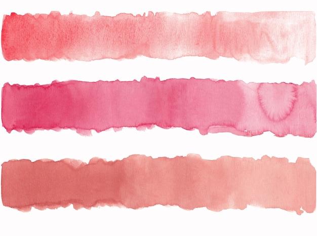 Handgezeichneter aquarellpinselstrich in rosa weichen farben isoliert auf weiß