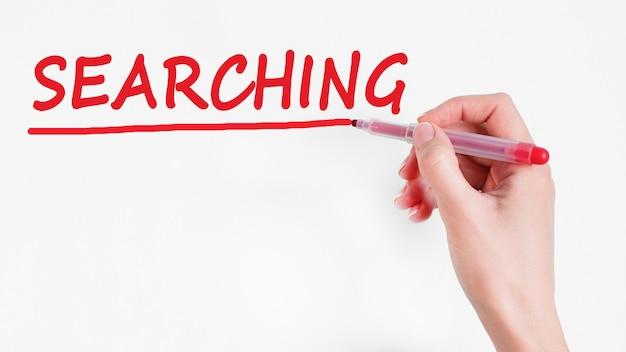Handschrift inschrift suchen mit roter farbmarkierung, konzept, stockbild