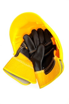 Handschuhe des erbauers in einem harten hut