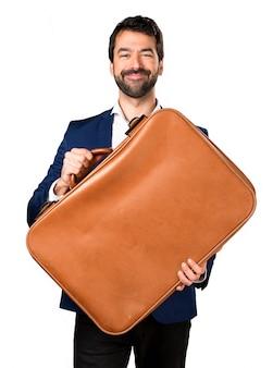 Handsome mann hält eine aktentasche