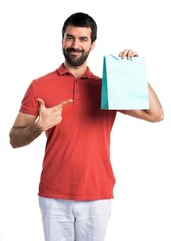 Handsome mann mit einkaufstasche