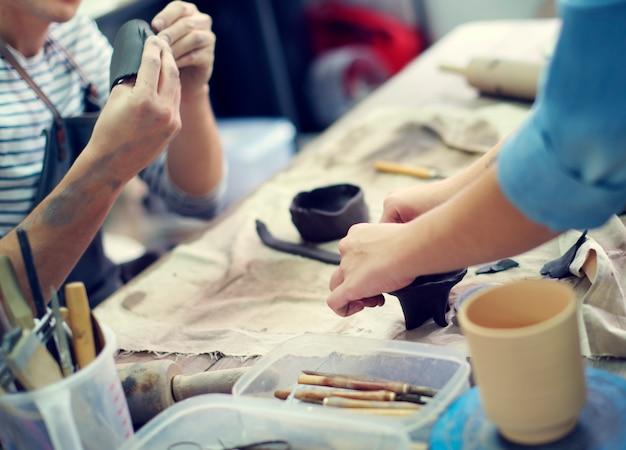Handwerker clay pottery creativity concept