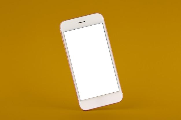 Handy auf farbigem tisch