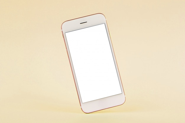 Handy auf gelbem pastell, technologie und busiess