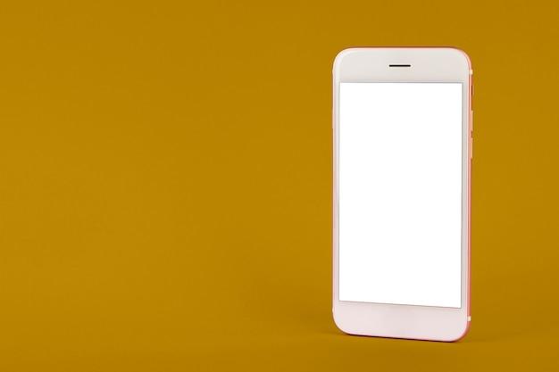 Handy auf gelbem tisch