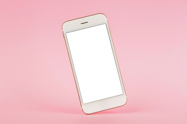 Handy auf rosa pastell, technologie und beschäftigt
