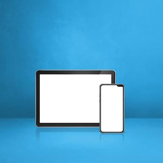 Handy und digitaler tablet-pc auf blauem schreibtisch. 3d-illustration