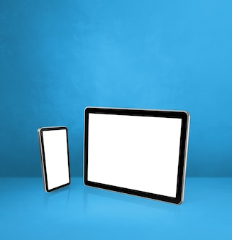 Handy und digitaler tablet-pc auf blauem schreibtisch