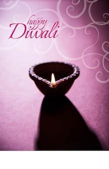 Happy diwali oder happy deepavali kreative grußkarte mit einem foto von diya oder öllampe