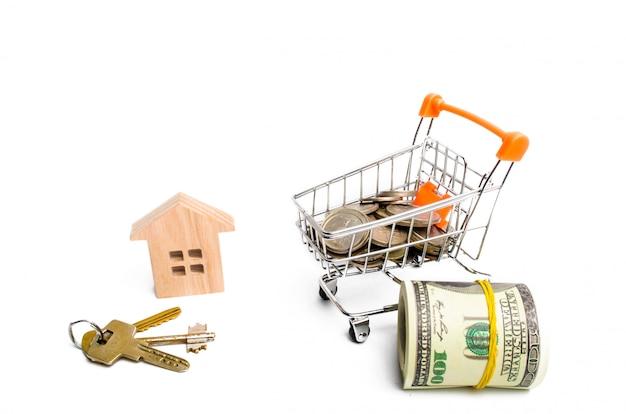 Haus und geld auf einem weißen hintergrund. das konzept des kaufs und verkaufs von immobilien