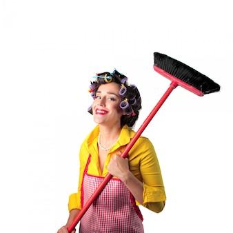 Hausfrau mit einem besen