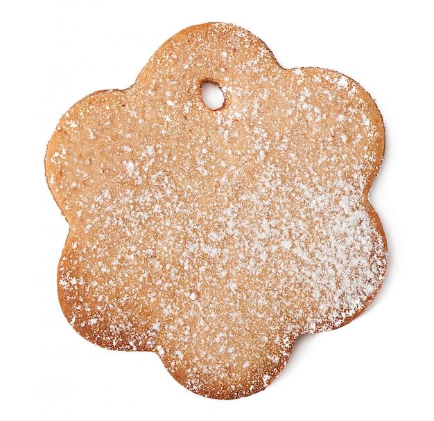 Hausgemachte kekse mit puderzucker bestreut
