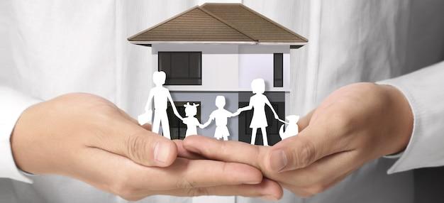 Hauswohnstruktur in einer hand, geschäftshausidee