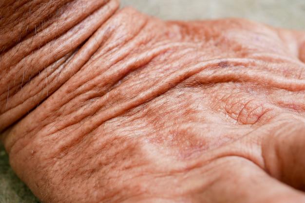 Haut des alten mannes der abstrakten hintergrundbeschaffenheit