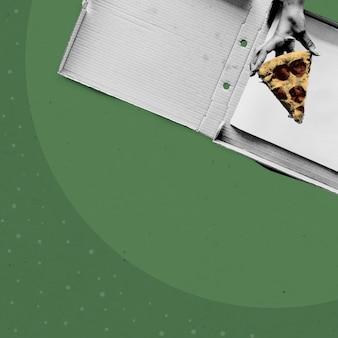 Heben sie mit der hand ein stück pizza auf grünem hintergrund auf