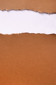 Heftige streifentitel-hintergrundvertikale des braunen papiers