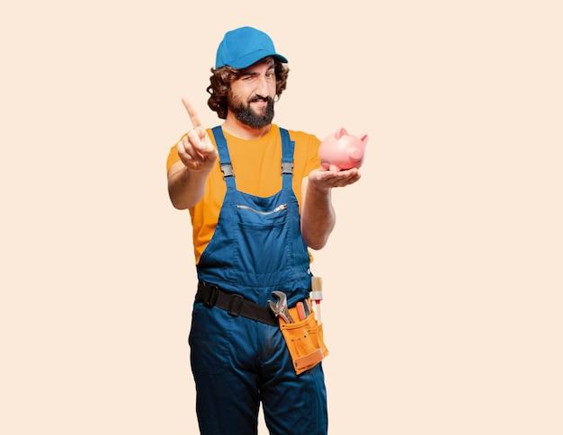 Heimwerkerarbeitskraft mit einem sparschwein