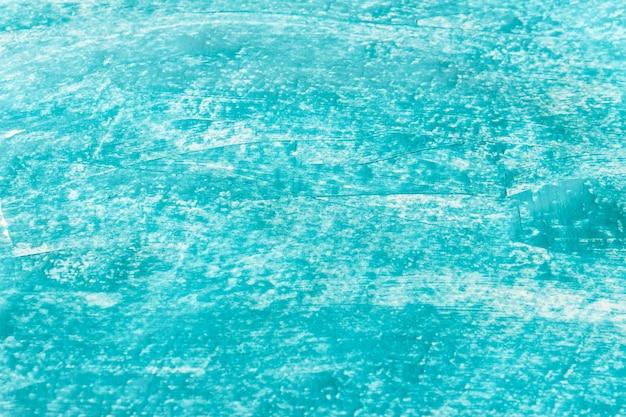 Hellblaue acrylfarbenbeschaffenheit mit kleinen anschlägen