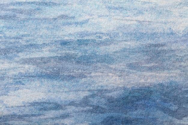 Hellblaue farben des hintergrundes der abstrakten kunst. aquarell auf leinwand mit weißem farbverlauf.