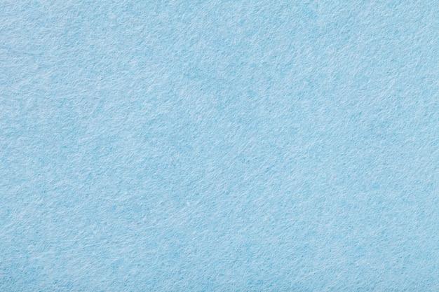 Hellblaue matte veloursledergewebenahaufnahme. samtbeschaffenheit des filzhintergrundes